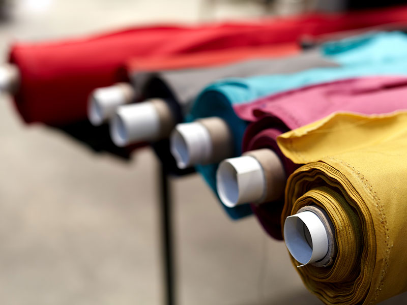 Rolls of fabrics in a variety of colours and prints